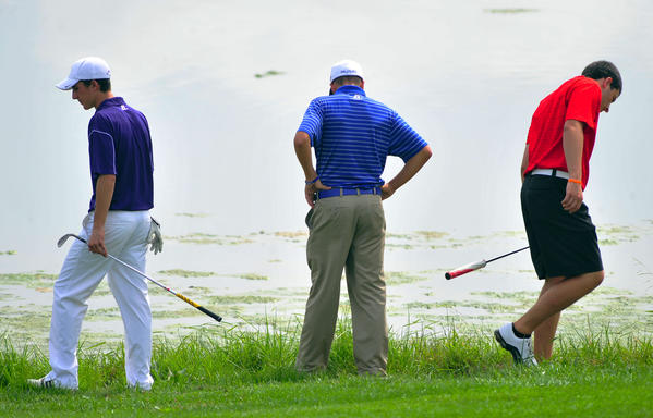 Williamsport's Ryan Crabtree, center, gets help searching for his ball in the water from Smithsburg's Kyle Huntzberry, left, and North Hagerstown's Nate Parchment, right, during Thursday's Washington County Public Schools Golf Championship at Black Rock Golf Course.