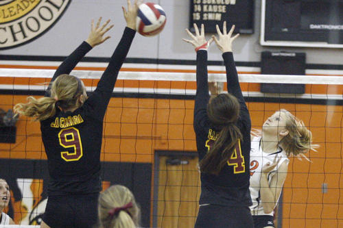 La Canada's Lauren Streeter, from left, and Leigh Sclafani block a spike from South Pasadena's Rowan Leddy during a game at South Pasadena High School on Thursday, September 27, 2012.