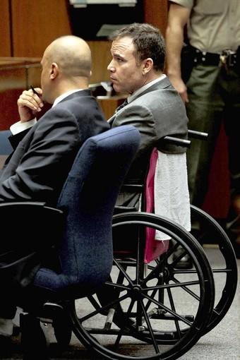 David Viens, right, sits in a wheelchair next to his attorney, Fred McCurry, as a jury convicts Viens of second-degree murder in the death of his wife.