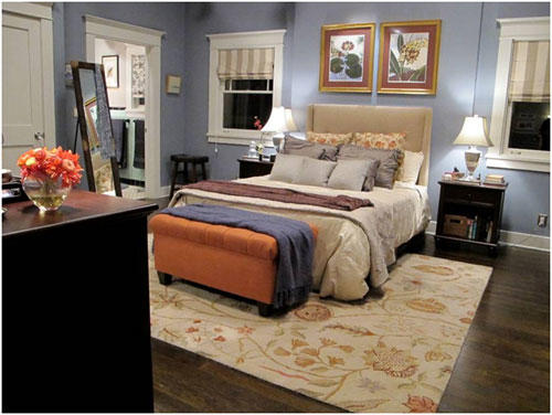"""Parenthood"" set decorator Julieann Getman describes Adam and Kristina's bedroom as a ""refuge from their fast-paced family life."" It is painted in soothing Van <a class=""taxInlineTagLink"" id=""PLGEO1001011113030000"" title=""Courtland"" href=""/topic/us/virginia/southampton-county/courtland-PLGEO1001011113030000.topic"">Courtland</a> Blue, a color in the Benjamin Moore Historical Collection. The headboard and bench were custom made. The rug, nightstands and dresser are by <a class=""taxInlineTagLink"" id=""ORCRP0000017187"" title=""Pottery Barn"" href=""/topic/economy-business-finance/consumer-goods-industries/furnishings-furniture-industry/pottery-barn-ORCRP0000017187.topic"">Pottery Barn</a>; the lamps are from Restoration Hardware. The stool and floor mirror were purchased at Upstairs Downstairs in Culver City. The linens come from Bed Bath Beyond. ""I shop a lot at Living Spaces,"" says Getman, who strives for realism rather than perfection. ""It's much more what people can truly afford as opposed to what they see in magazines."""