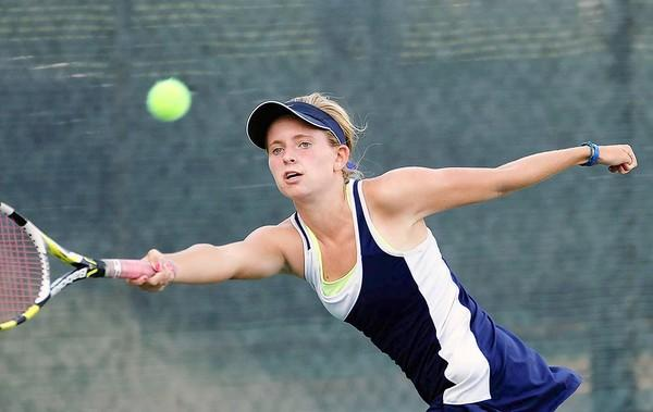 Newport Harbor High's Kate Knight stretches for a ball.