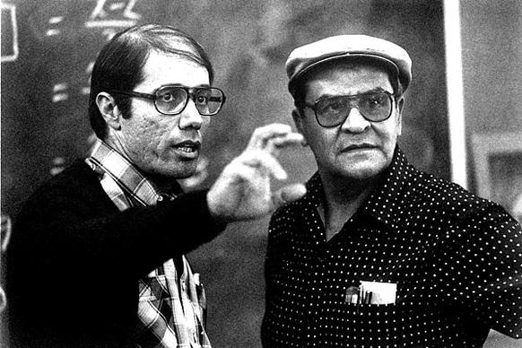 "Actor Edward James Olmos, left, compares notes with teacher Jaime Escalante during the filming of ""Stand And Deliver"" in 1988. Escalante died Tuesday at his son's home  in Roseville, Calif. He was 79."