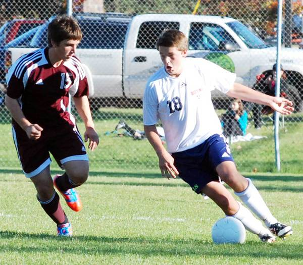 Boyne City senior Steven Halstead (right) controls the ball as Charlevoix senior Jordan Jelinek defends during the first half of Thursday's Lake Michigan Conference match in Boyne City.