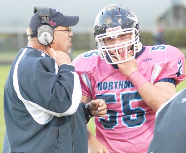 Petoskey coach Kerry VanOrman (left) talks to senior lineman Jordan Haggerty during the Northmen's 33-14 non-league win over Cheboygan last week at Curtis Field. Petoskey, 3-2, plays a Big North Conference game at Gaylord, 0-5, today, Friday.