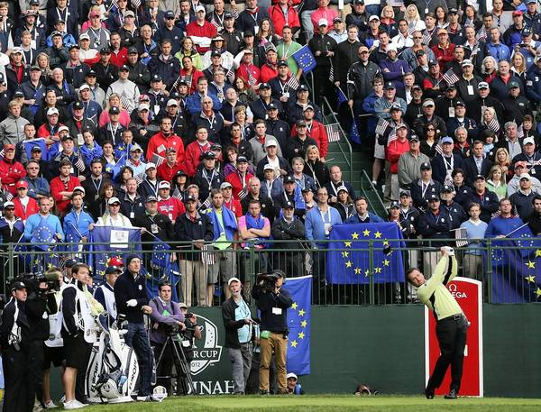 Ryder Cup player Graeme McDowell of Europe hits the first shot of the matches during the morning foursome competition at Medinah Country Club.