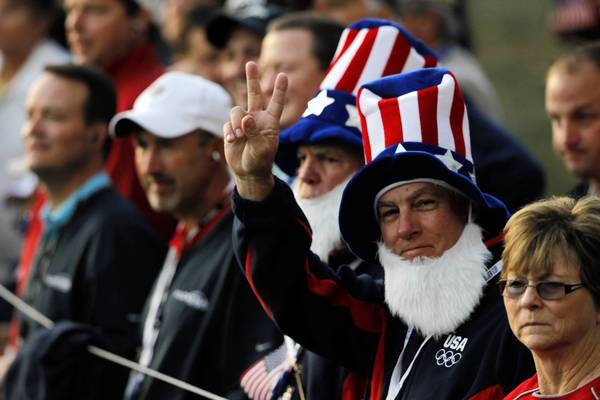 Ryder Cup fans show their team spirit along the number one fairway on the first day of the Ryder Cup competition at Medinah Country Club.