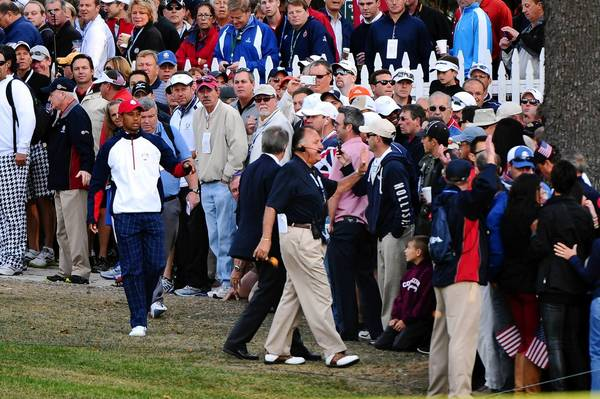 Tiger Woods moves the crowd along the first hole rough during day one of the 39th Ryder Cup at Medinah Country Club.