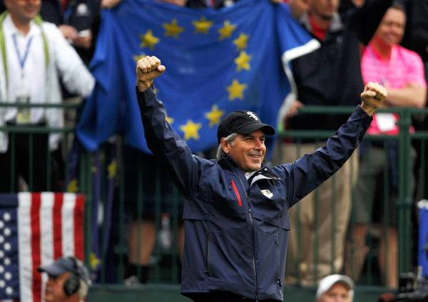USA Ryder Cup vice-captain Fred Couples acknowledges the crowd's cheers on the first tee during the morning foursomes round at Medinah Country Club.