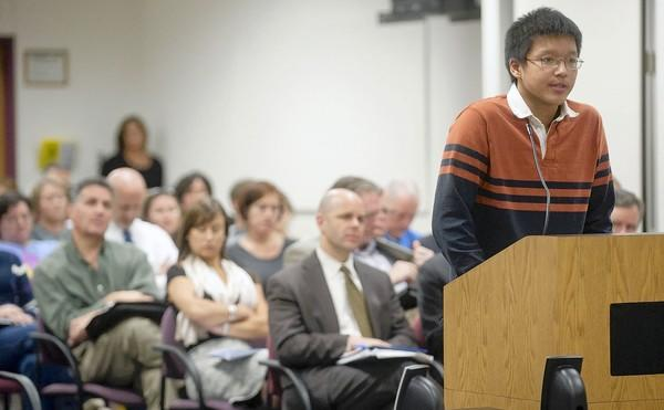 Emmaus senior Neil Ren, age 17, speaks as the East Penn School board prepares to vote on whether to pull Electric Kool-Aid Acid Test and Prep from summer reading list during their meeting in Emmaus on Monday.
