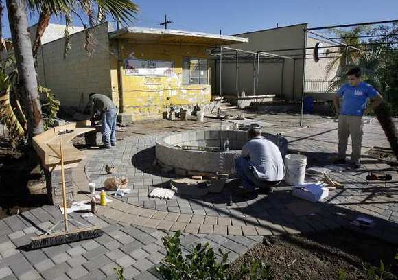 A crew works on the landscaping for outdoor dining in Burbank in January. Formerly Lucky Plants, the site was being renovated to be a restaurant and coffee shop with outdoor dining on San Fernando Boulevard.