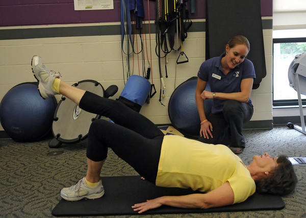 April Chevalier works with Linday Linlay on an exercise used in the YMCA's program called Livestrong. It provides a 12 week free membership for cancer survivors of any type, any time, who learn how to live a healthier life. The classes teach how to use the various machines, provide mini classes in zumba, yoga, wall climbing, water aerobics, as well as information about nutrition and wellness.