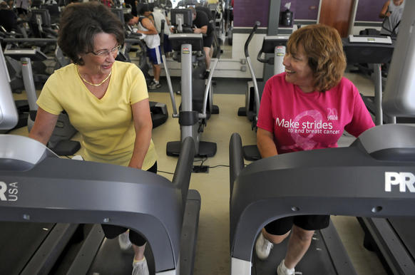 (L to R) Linda Finlay and Sheryl Simoni warmup on the treadmill at the YMCA while working out to a new program called Lifestrong in some of its branches. It provides a 12 week free membership for cancer survivors of any type, any time, who learn how to live a healthier life. The classes teach how to use the various machines, provide mini classes in zumba, yoga, wall climbing, water aerobics, as well as information about nutrition and wellness. Both have had breast cancer.  Photo by JOHN WOIKE | woike@courant.com