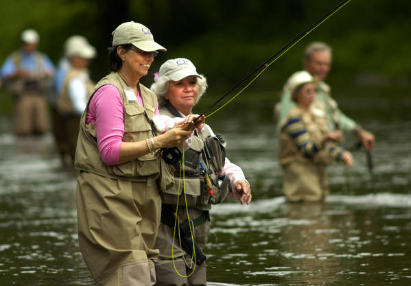 2006:  Breast cancer survivor Karen Como (left), of Westport, and her fly fishing guide Diane Sablitz (right) fish the Housatonic River in West Cornwall Sunday as part of the Casting for Recovery retreat. Fourteen women, all survivors of breast cancer, participated in the Casting for Recovery retreat.