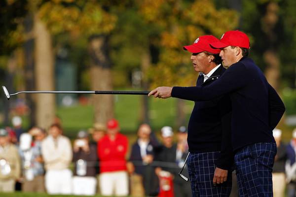 USA Ryder Cup Team members Keegan Bradley, right, chats with teammate Phil Mickelson on the third fairway on the first day of competition at Medinah Country Club.