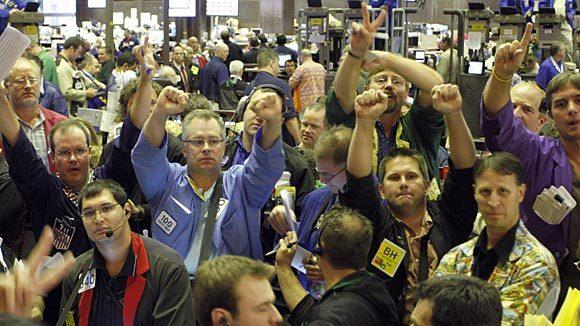 Traders in the corn options pit of the Chicago Board of Trade signal orders in Chicago in 2008.