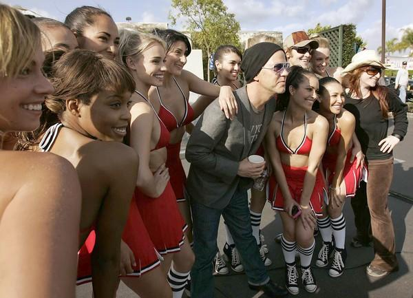 'Glee' creator and executive producer/director Ryan Murphy (center) has his photograph taken with dancers on the set of the new Fox musical TV comedy.
