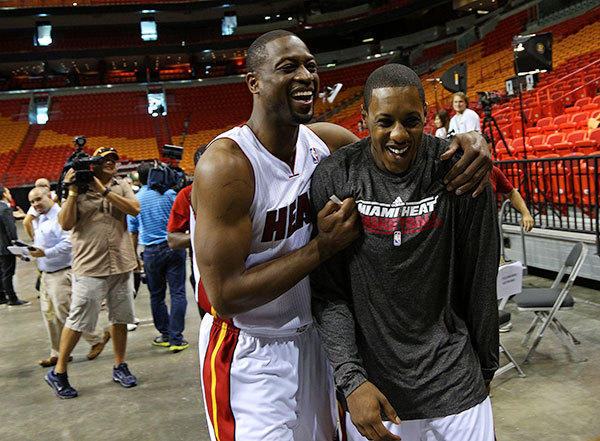 LDwyane Wade and Mario Chalmers share a laugh during the Miami Heat media day.