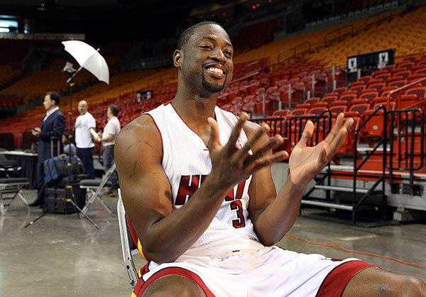 Dwyane Wade laughs during an interview during the Miami Heat media day.