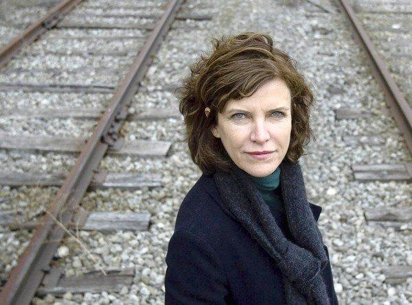 Jeanne Gang of Studio Gang Architects, stands on a railway next to the former Hawthorne Works factory complex earlier this year. The land is the type of former factory property in Cicero that exists in other area that she would like to develop into a new form of low-cost housing.