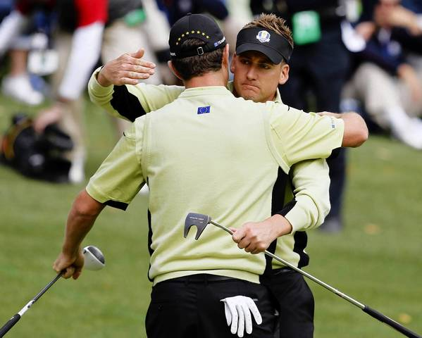 Europe's Justin Rose (left) and Ian Poulter celebrate their win over USA's Tiger Woods and Steve Stricker during the first round of the Ryder Cup.