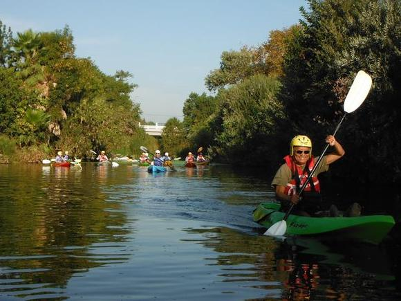 Bruce Saito, executive director of the L.A. Conservation Corps, leads a group of kayakers on the L.A. River on Thursday.