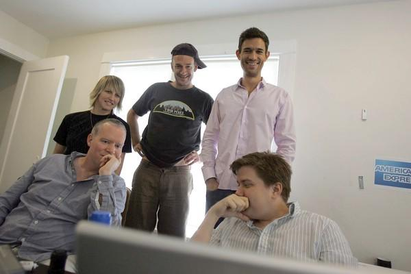 FunnyorDie head of production Mike Farah, standing at right, with cap-wearing writer-actor Seth Morris and other staffers.