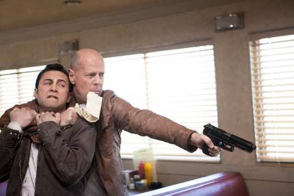 "Joseph Gordon-Levitt and Bruce Willis as ""Joe"" in ""Looper."""