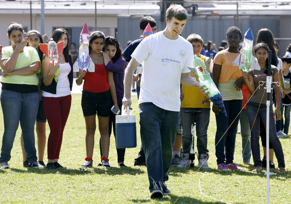 Citrus College student Andrew Ferguson helped Wilson Middle School students launch water rockets during the Math & Engineering Program (MESA) class at the Glendale school on Friday, Sept. 28, 2012.  The rockets were made from empty two-liter plastic bottles filled with water and pumped with air.  The students were assisted by a group of students named The Rocket Owls from Citrus College and Cal State L.A.