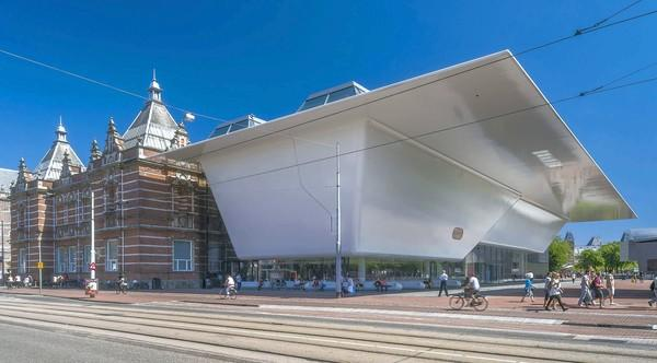 "Stedelijk Museum view shows the original building and new building dubbed the ""bathtub"" designed by Benthem Crouwel Architects."