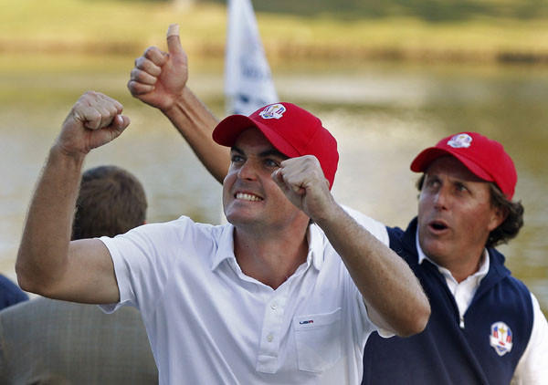 U.S. golfer Mickelson and Bradley celebrate after defeating Team Europe golfers McIlroy and McDowell on the 17th green during the afternoon four-ball round at the 39th Ryder Cup matches at the Medinah Country Club. (Reuters)