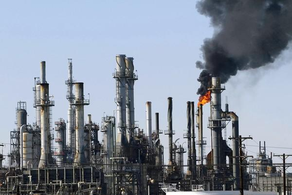 "Black smoke rises from the ConocoPhillips oil refinery in Los Angeles. President Obama and GOP candidate Mitt Romney tout an ""all-of-the-above"" energy strategy, but the candidates emphasize different fuels."