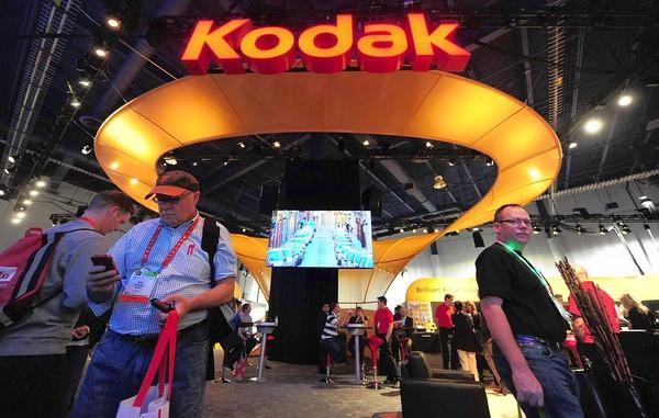 A 23% cut in jobs will leave Kodak with 13,100 workers. Above, visitors to Kodaks display at this years Consumer Electronics Show in Las Vegas.