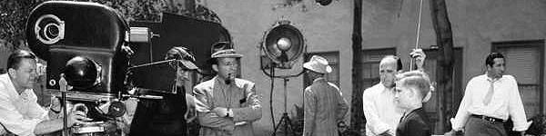 [Bing Crosby's oldest son, Gary Evan, 11, faces a movie camera in a War Bond Short during a lull in the filming of ¿The Bells of St. Mary¿s¿ in Hollywood, Los Angeles on June 8, 1945. Bing and director Leo McCarey are beside the camera. (AP Photo)] *** []