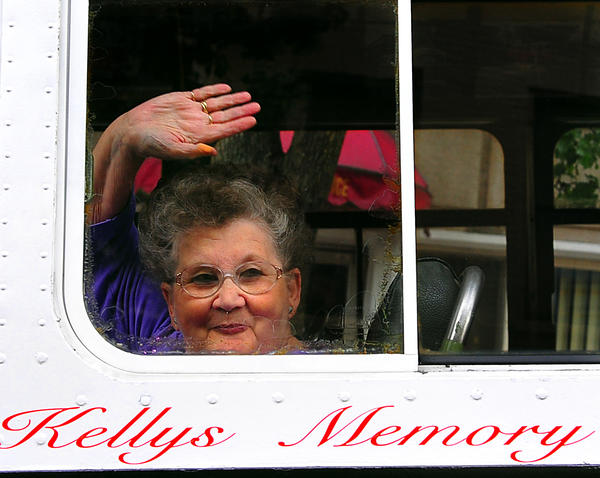 Betty Kelly waves to friends from a seat on the 1947 Brill transit bus owned by her and her husband Gene. The bus was the last transit bus operated by the Potomac Edison Company in Hagerstown. It was last used in the early 1970s.