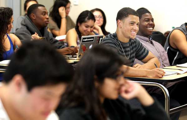 Roommates Jeffrey MacGillivray, center, and Randall Jenkins, right, both 20, enjoy their philosophy class at El Camino College in Torrance. Philosophy was the only academic course that MacGillivray was able to secure a spot in this semester.