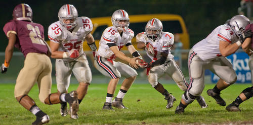 Parkland quarterback Dalton Burrows (15) fakes a handoff to his running back Chad Rex (70) as George Taylor (35) rushes to block Whitehall defensive back Jared Elder (21) in the second quarter of their game at Whitehall High School on Friday night.