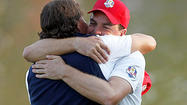Arm in arm, Keegan Bradley and Phil Mickelson ended their first day of the Ryder Cup by wearing goofy grins as they bounced blissfully toward the 17th green, a match made in Medinah.