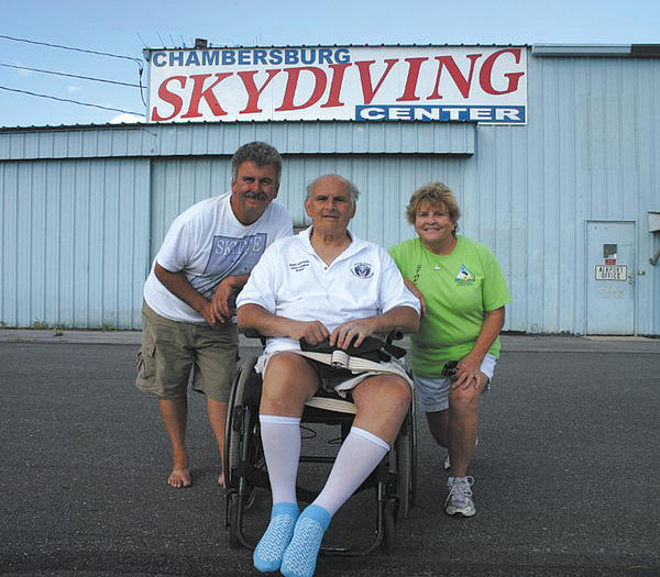 J. R. Sides and his wife, Kathy Sides, co-owners of the Skydiving Center at Chambersburg, Pa., are shown along with Randy Schroeder at the opening ceremony of the Mobility for Randy fundraiser.