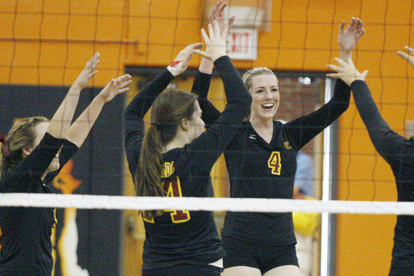 La Canada's Kendall Walbrecht celebrates with her team a high five after making a point against South Pasadena.