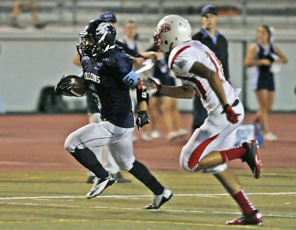 Crescenta Valley runningback William Wang out runs Pasadena's Andres Arias for a first quarter touchdown in a Pacific League football game at Glendale High School on Friday, September 28, 2012.