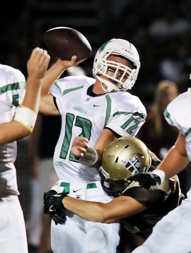 St. Francis' Cole Ramseyer (51) tackles Monrovia quarterback Blake Heyworth (12) during the first quarter of their prep football game against Monrovia at St. Francis High School on Friday, Sept. 28, 2012 in La Canada, Calif.  ( Photo by Libby Cline)