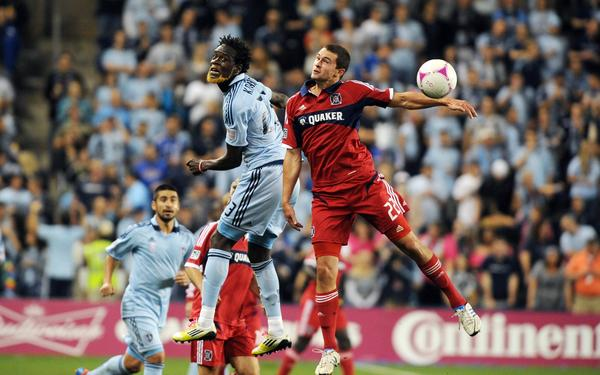 Austin Berry and Sporting KC's Kei Kamara go for a header in the second half at Livestrong Sporting Park. Kansas City won 2-0.