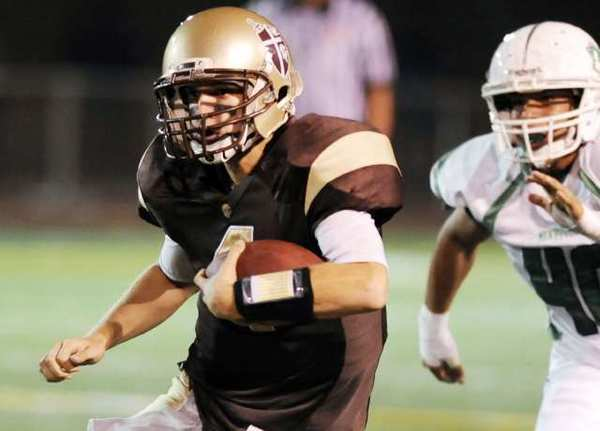 St. Francis' quarterback Jared Lebowitz runs through the Monrovia defense.