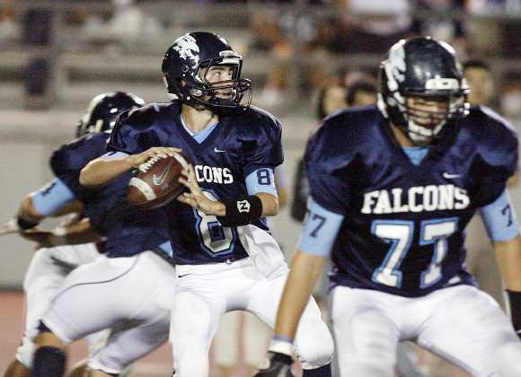 Crescenta Valley quarterback Joe Torres drops back for a long pass against Pasadena.