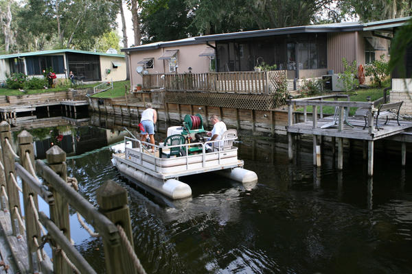 A canal where an  alligator attacked an elderly woman in a canal in a  Leesburg-area mobile home park, is shown here on Wednesday, September 26, 2012. Carol Hough, 84, was airlifted to Orlando Regional Medical Center, according to the Lake County Sheriff's Office.