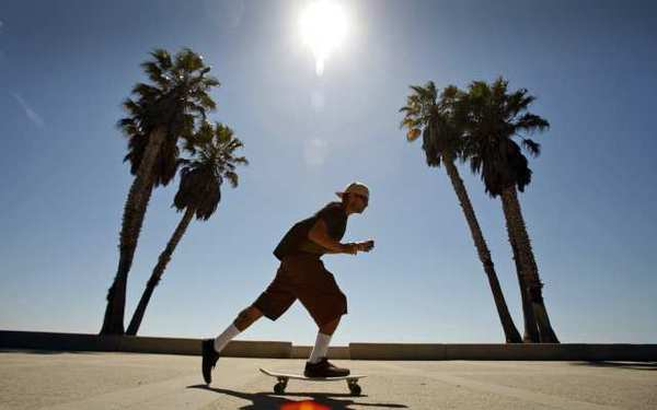 Myers, 27, of Ventura works his skateboard as he enjoys the beautiful weather last week at Seaside Park in downtown Ventura.