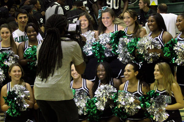 Sun Sentinel videographer Matt Williams flms Flanagan High School cheerleaders during the Sun Sentinel Pep Rally.