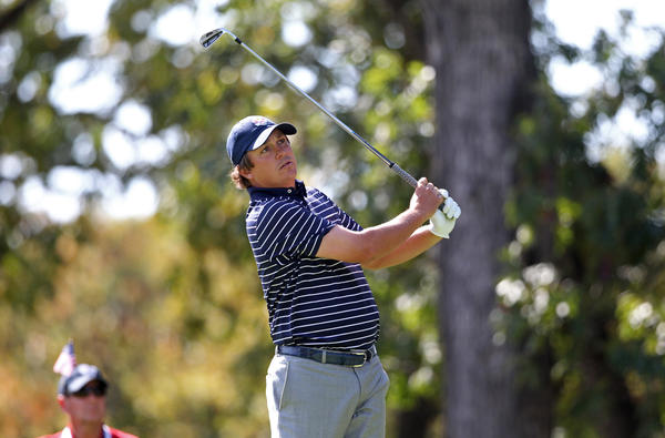 Jason Dufner follows his tee shot on the 17th hole Saturday morning.