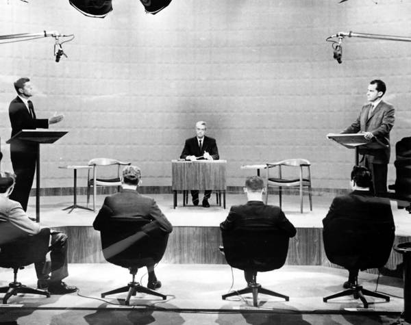 John F. Kennedy and Richard Nixon hold the nation's first televised debate in 1960 in Chicago.