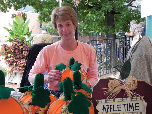Kim Sheeder of Grannies Attic in McConnellsburg, Pa., stitches a fabric pumpkin Saturday at the 33rd annual Mercersburg (Pa.) Townfest.